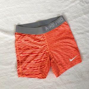 nike pro shorts orange print